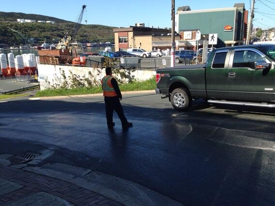 Gentleman directing traffic cuz of a cooking oil spill at top of... Hill O Chips. Yup, can't make it up. #nltraffic http://t.co/T37j1ruXJ3