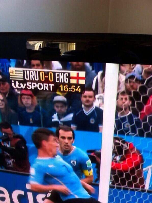 BqhZhYxCEAAnEXa Tartan Army in Brazil! Scottish fans spotted in the Uruguay section celebrating Suarez goals v England