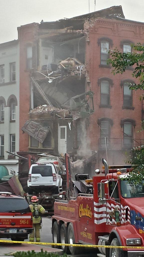 Photo Side Of Building Partially Collapses After Truck
