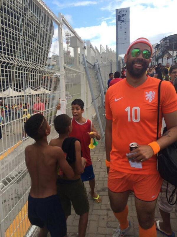 This man had two extra tickets to the Spain-Holland game. Instead of selling them, he gave them to this boy #Kindness http://t.co/6kdoOX4Njb