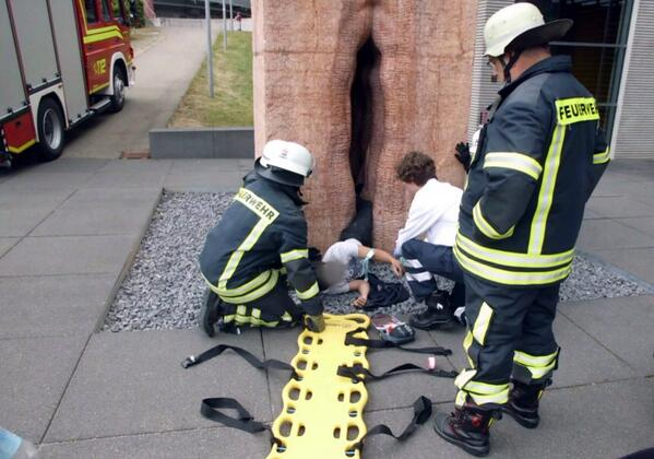 American student saved by 22 German firefighters after getting stuck in giant vagina sculpture http://t.co/dCF440DxAQ http://t.co/PLjUCcI4SP