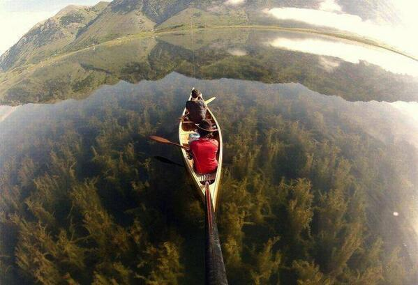 Canoeing in a crystal clear lake, Italy. http://t.co/01n5VIua0d