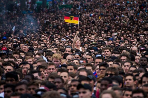 Great shot of a German fan in Paris celebrating Germany's World Cup win over France - by Ian Langsdon/EPA http://t.co/yfZhJVYeg3