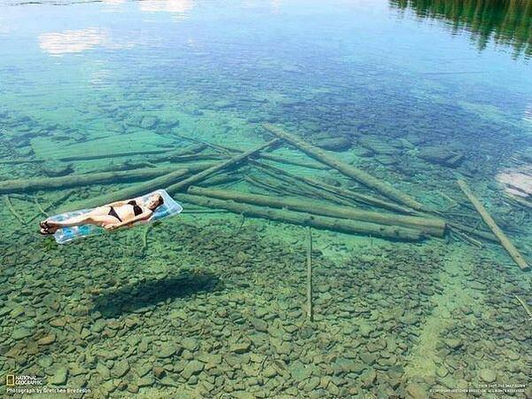 The crystal-clear water, Flathead Lake in Montana seems shallow, but in reality is 370 feet in depth. http://t.co/x92FT92ZiV
