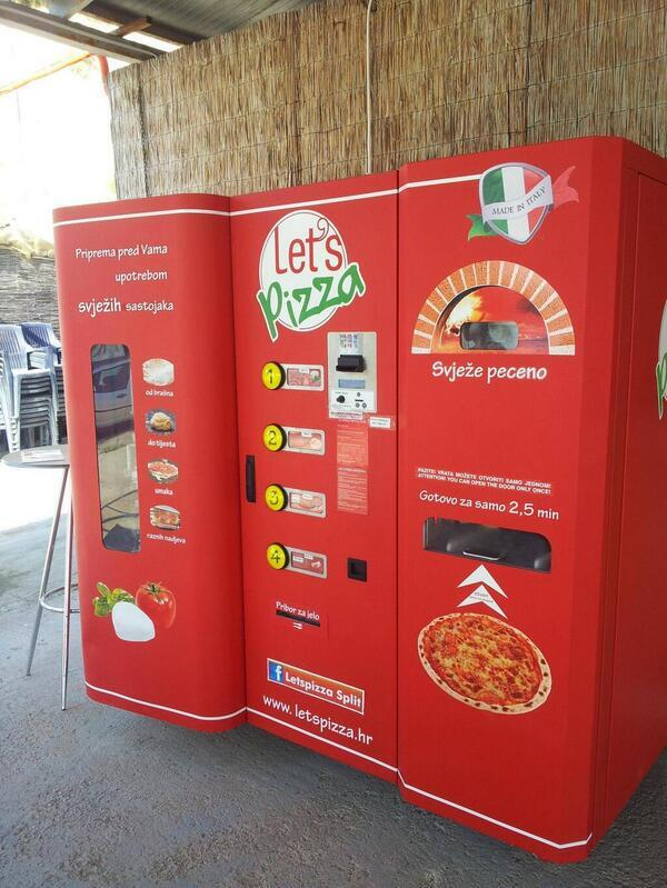 This is a pizza vending machine in Croatia. You pick the toppings and it actually bakes it for you right there! http://t.co/VBZgO4eQkb