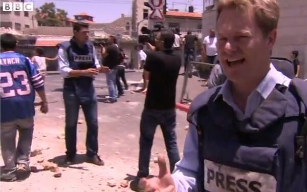 In grave BBC report on tensions in E. Jerusalem, an unexpected sight: Bills-era #23 Lynch uni http://t.co/eMkmxHqfIH http://t.co/ia12mzoq3p