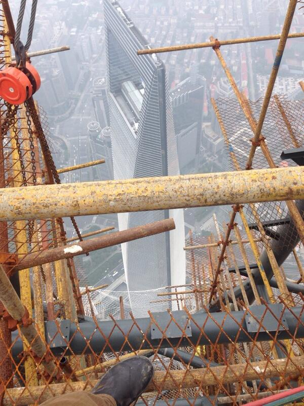 Standing on the edge of Shanghai Tower, about 2000 feet in the air. my foot is feeling brave. http://t.co/VqJ9POf9Kl