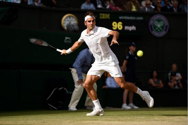 Federer returns a shot against Raonic [via @wimbledon]