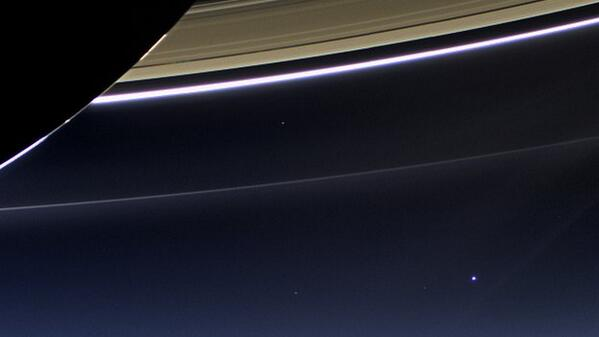 Earth (bottom right) from nearly a billion miles away, taken from the 10-year-old Cassini probe orbiting Saturn http://t.co/gf90rRlEYG