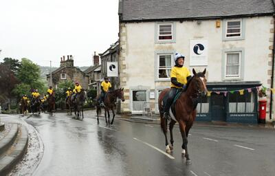 MJR welcomes Le Tour! Out in yellow this morning to celebrate the Tour de France passing Kingsley House today. http://t.co/6vdHqGbvia