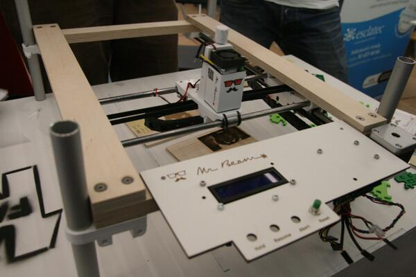 Portable laser cutter by @MrBeamLasers #fab10 #fabfestival becauser everything is cooler with a laser http://t.co/9qwXXQTDCm
