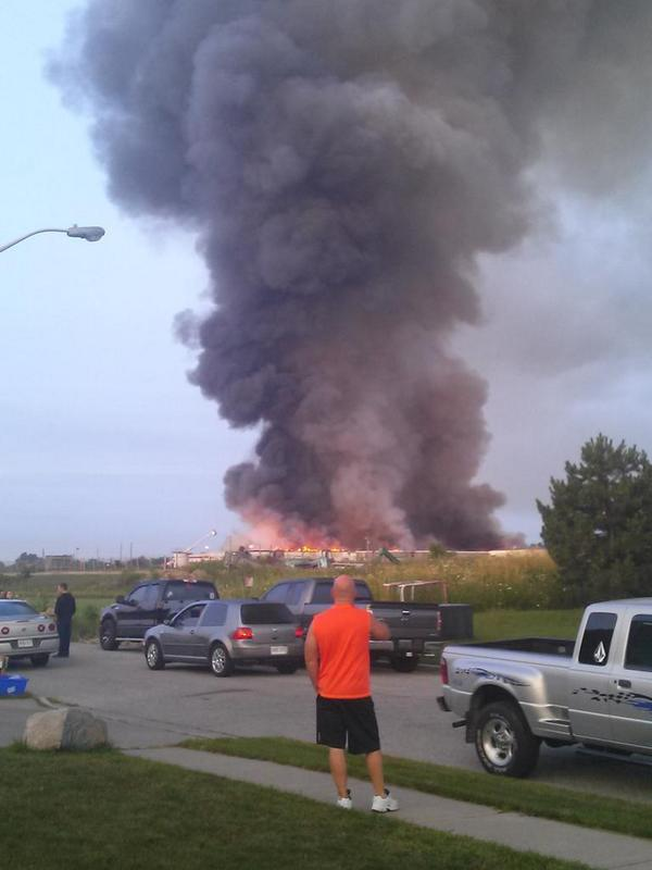 Massive fire at a plant in Tecumseh #Ontario can reportedly be seen from across the American-Canadian border. http://t.co/jA4PER1And