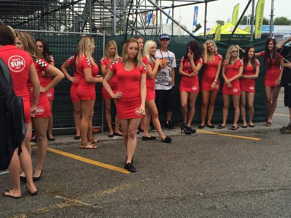 The @hondaindy grid girls just hanging out before the @IndyCar #2inTO Race 1 http://t.co/2v30wyTdRT