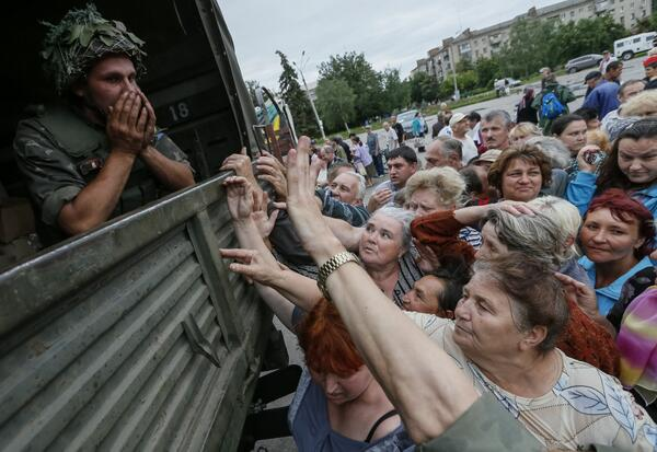 A look at life in Ukraine's Slaviansk, a rebel stronghold retaken: