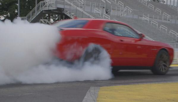 The quarter-mile in 11.2 sec? @Dodge #Challenger @driveSRT #Hellcat #HEMI does that! Watch: http://t.co/iGDcD31Vmk http://t.co/yCNlgLfa97