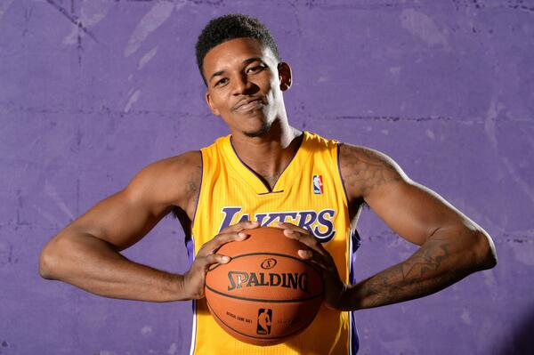 Official: #Lakers re-sign Nick Young (@NickSwagyPYoung) for four more years » http://t.co/3TvaVGAVgH | http://t.co/KPtGMMTZcN