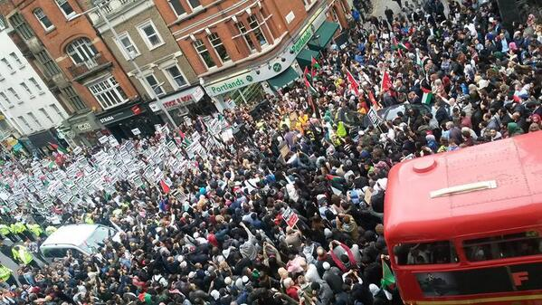 Protesters outside Israeli embassy in #London on 11th July, showing support for #Gaza. http://t.co/Uti4NUrWpG http://t.co/fVte6oyFlp