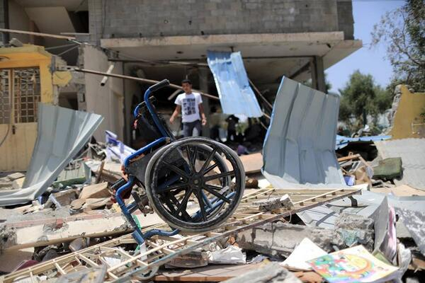 Poignant photo by Wissam Nassar of an Israeli attack on a disabled centre in Gaza that reportedly killed four: http://t.co/43U0b6R7QL