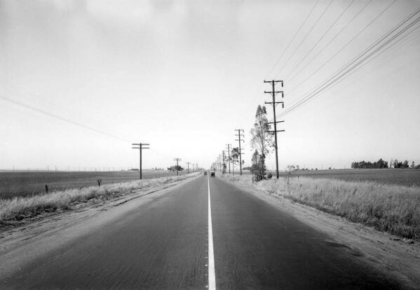 This rural highway is actually Western Avenue in South Los Angeles, as seen in 1932. http://t.co/tLcpqrCR90 http://t.co/zdOv0abik6