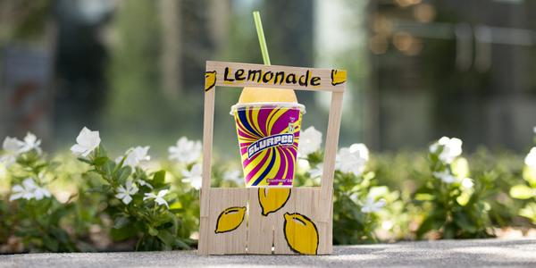 We've set up the world's best lemonade stand: our store. New Lemonade Slurpee is made with real fruit juice. http://t.co/6fKpBz7IZS