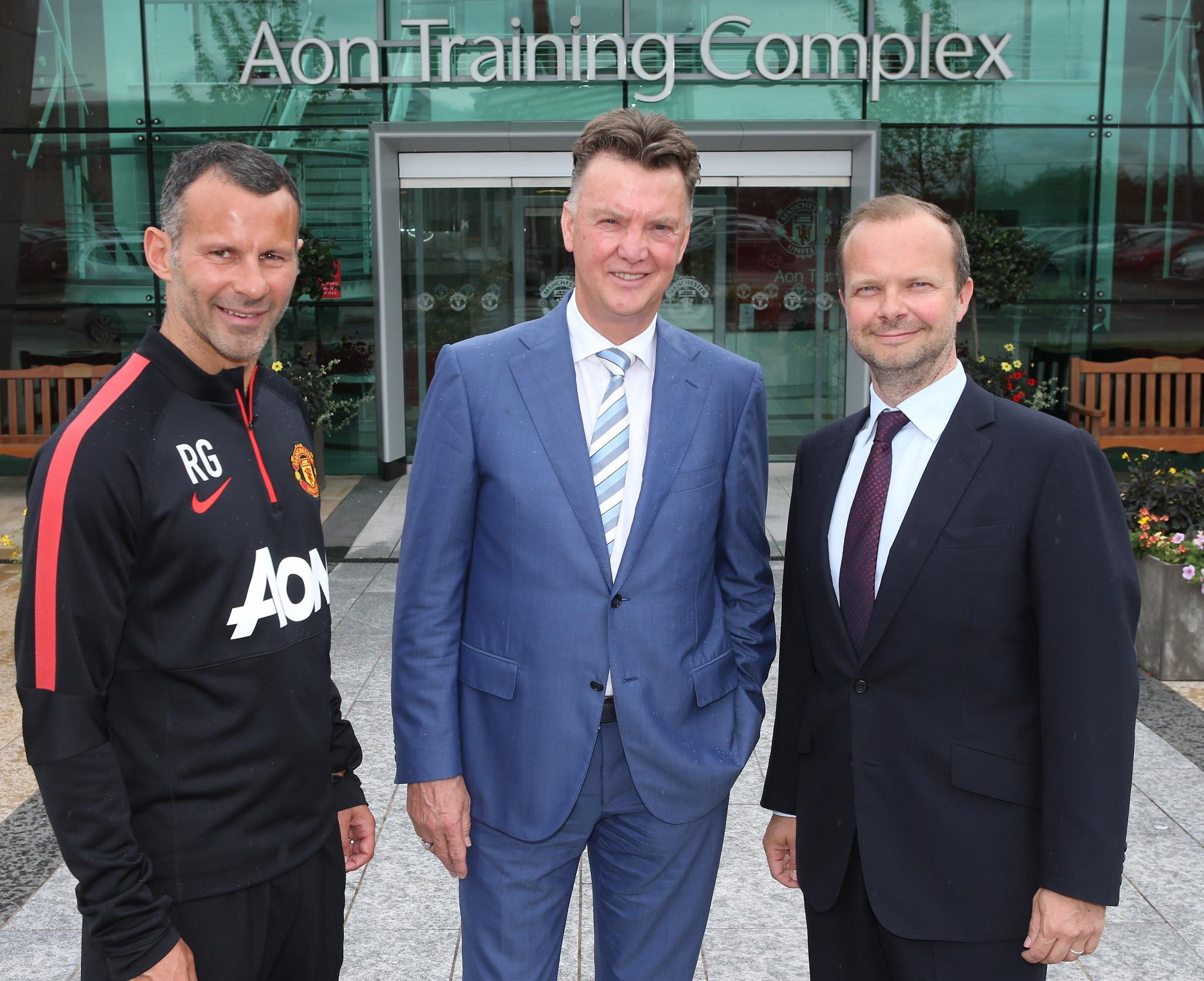 The Louis van Gaal era has begun! New Man United boss poses for pictures on first day at club