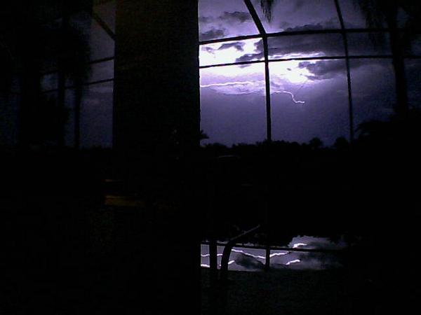 Lightning over the lanai last night in FL, captured by the Foscam webcam. Love the bolts reflected in the pool. http://t.co/qzLlyE9gv8