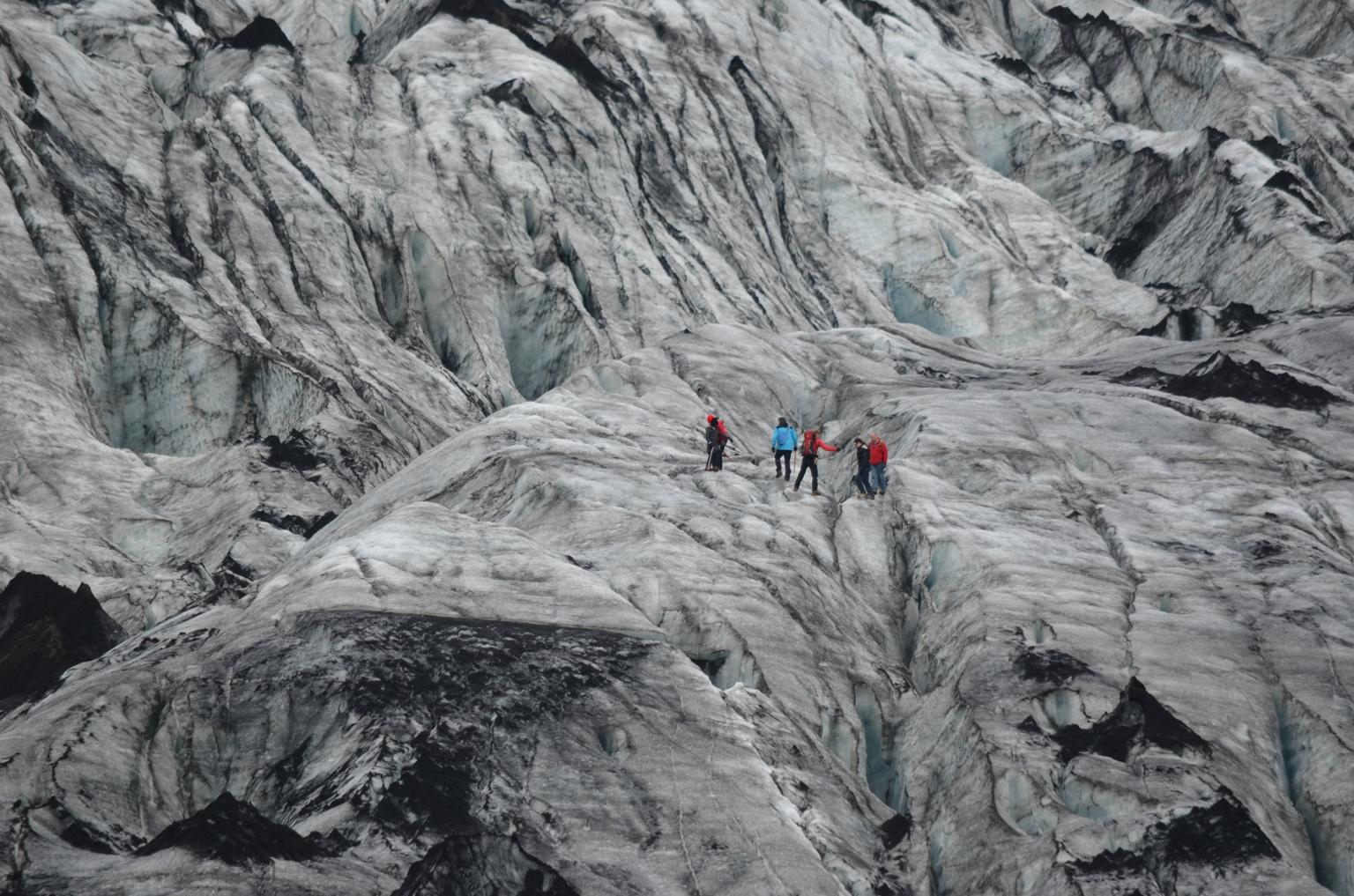 RT @alexisaverbuck: Crossing a crevasse at Sólheimajökull glacial tongue in south #iceland. http://t.co/dA1r0qCGKp #lp #travel