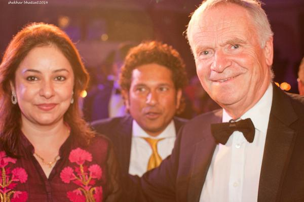 There I was, having my photo taken with Mrs Tendulkar, when an unknown Indian cricketer tried to join us... http://t.co/sjUNCrqses