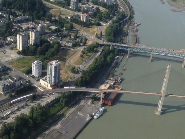 @chad_dey snapped a shot of the trains stuck on the skybridge btwn #NewWest & #SurreyBC Hang in there all! #SkyTrain http://t.co/W1mB3Xfj6i