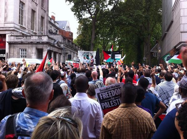 """""""In our millions, in our billions - We are all Palestinians!"""" #Gaza protest closes roads at #Israel's London embassy http://t.co/sjFG02Rei8"""