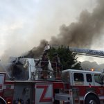 Major house fire in the Elmwood Village. Elmwood near Delavan. http://t.co/h4jjXXXwmV