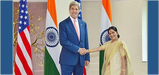 A towering John Kerry was welcomed by a petite Sushma Swaraj
