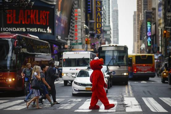 Photos: A day in the life of an Elmo in Times Square http://t.co/SbggIzTkQI http://t.co/8keBZdrq8r