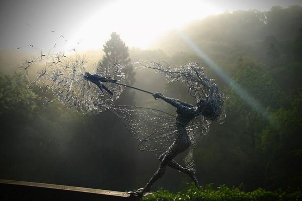 UK sculptor Robin Wight creates dramatic scenes of wind-blown fairies clutching dandelions #Robin #Wight #fairies