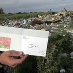 "RT @am_suhaimi: A ""kad raya"" was found at the crash site of Malaysia Airlines #MH17. Absolutely heartbreaking. http://t.co/wjZn32CxlD"
