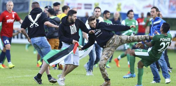 Sickening scenes as Maccabi Haifa players attacked by protesters  during a 'friendly' v Lille. Match abandoned http://t.co/HpHQEzk4V4