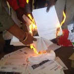 RT @ewnreporter: #CosatuEtolls Photo: Cosatu NTA and Council of Churches officials burning e-Toll bills. GW http://t.co/DhhFEGg9MR
