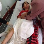 "RT @sharifkouddous: Rehab, 10, wounded in leg when Israel shelled UN school in Beit Hanoun. ""Shells fell on us while we were sitting"" http://t.co/yUQX1WJlLp"