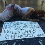 At Hollywood Walk of Fame, a spanish girl protesting for Palestine. #SaveGaza http://t.co/0Z1J7a1Fmh