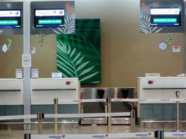 the Malaysian Airlines check-in counter at Penang Airport.