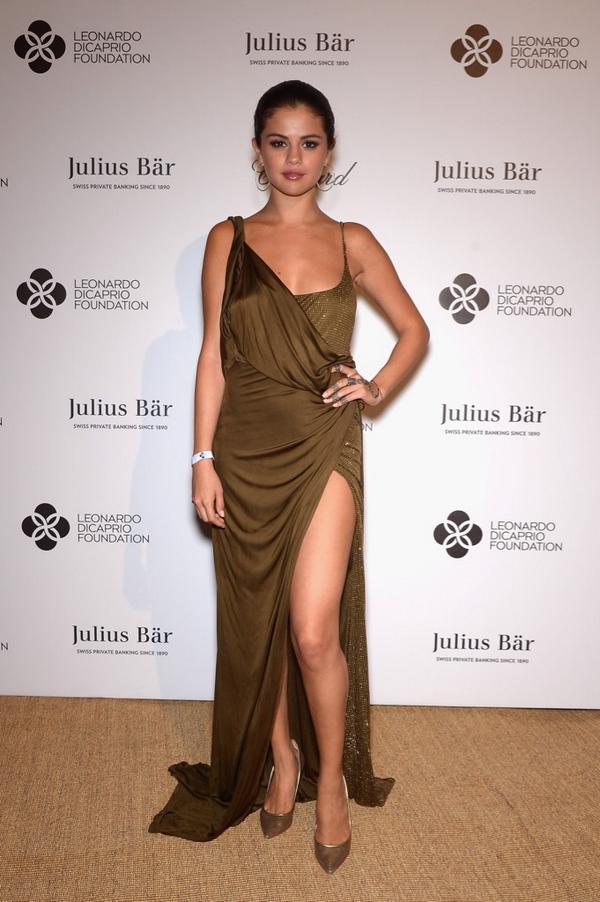 Selena Gomez wears a Pucci dress to the Leonardo Dicaprio Foundation Launch at Domaine Bertaud #puccigirl (© Getty) http://t.co/tC8IHHYy14
