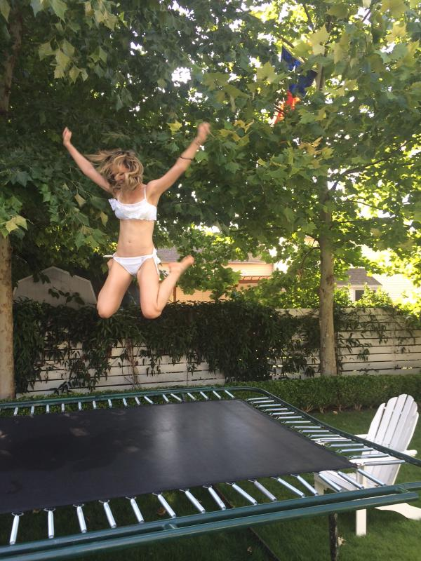 Bobby Bones (@mrBobbyBones): here's a picture of @radioamy today jumping on a trampoline in a bikini. She is going to kill me for posting this. http://t.co/AHsbP9rmR3