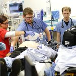 FAST HANDS: Our team is working quickly to stabilize this critically ill patient. #InsideIUH #TraumaNight http://t.co/ny7w3Nm1Ru