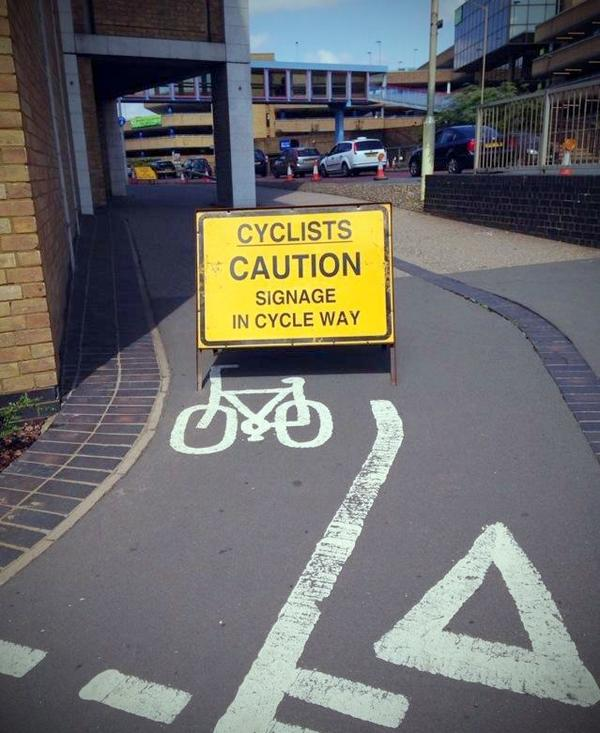 Sign warns cyclists about itself! Retweet if this made you chuckle. http://t.co/rY6tjHdfqz