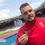 Team captain @AledDavies2012 with his shiny new medal. #GoWales http://t.co/1SY1063t6Y