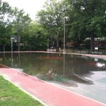 Hours after this mornings storm, the bball courts at Hynes Field in #westroxbury remain flooded. @universalhub http://t.co/Jz4SV4CNwk
