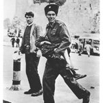 Palestinian policeman carries a child killed by Irgun, Dec 47. Zionisms war against Palestinian children is old. http://t.co/FryJXYX2iy