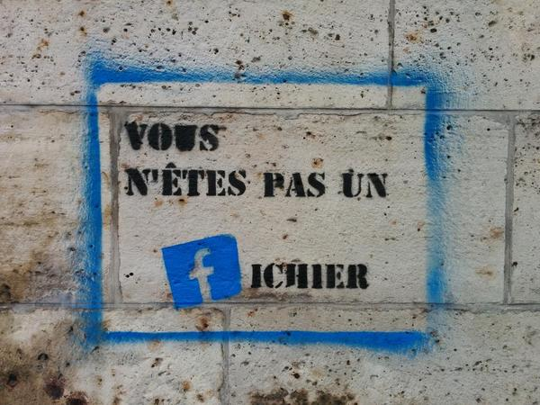 """Seen on a Paris wall: """"You are not a (Facebook) File"""" - http://t.co/NRY9TeYxsG"""