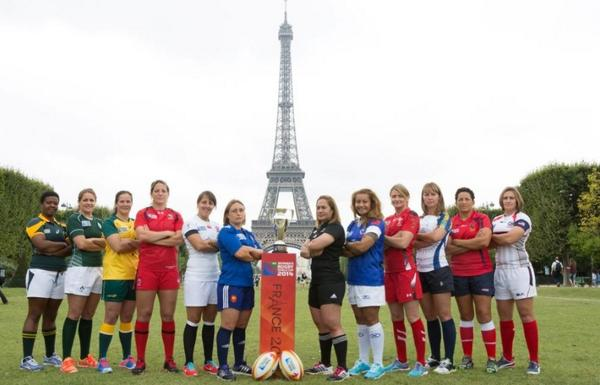 All 12 captains pose outside the Eiffel Tower to launch #WRWC2014 this morning #wrugby http://t.co/zlYEeZv8JX