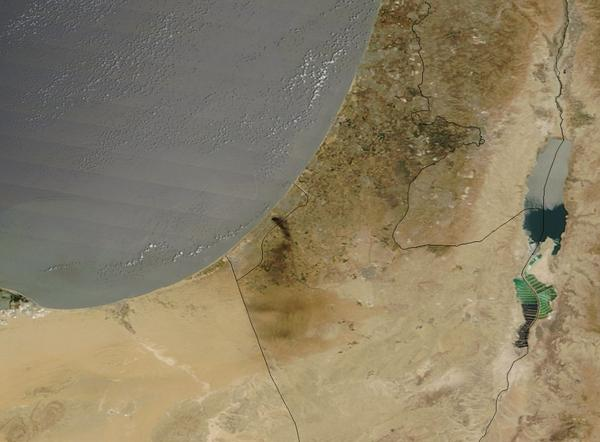 Fuel depots of Gaza's only power plant were hit. This is a satellite photo of the huge thick black smoke. http://t.co/Do6MARPYrb